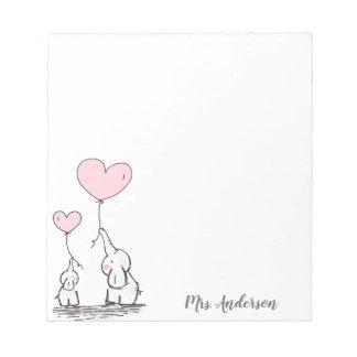 Cute elephants holding heart shaped balloons notepad