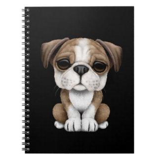 Cute English Bulldog Puppy on Black Notebooks