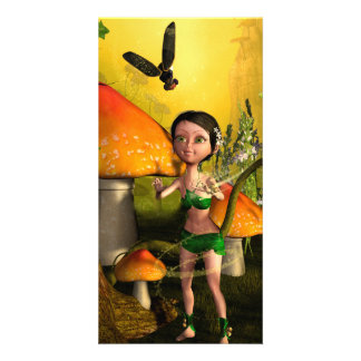 Cute fairy playing with a firefly picture card