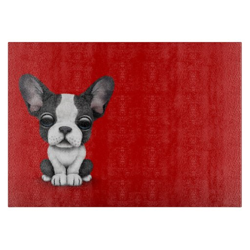 Cute French Bulldog Puppy Dog on Red Cutting Board