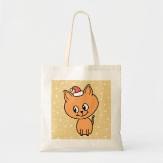Cute Ginger Kitten Wearing a Christmas Hat Tote Bag
