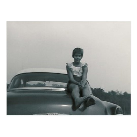 cute girl sitting on back of old car post card