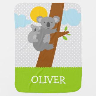 Cute gray koala bear receiving baby blanket