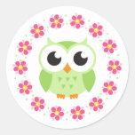 Cute green owl inside pink flower border round sticker