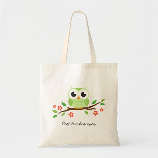 Cute green owl on floral branch best teacher ever tote bags