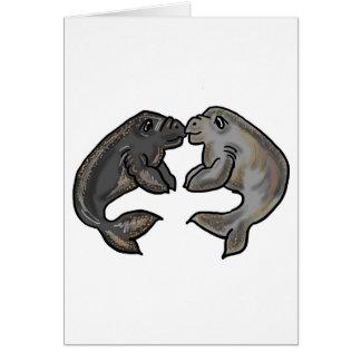 Cute kissing manatees design greeting card
