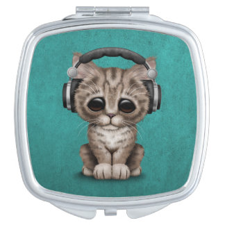 Cute Kitten Dj Wearing Headphones on Blue Mirror For Makeup