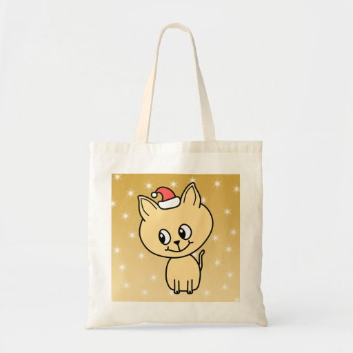 Cute Kitten in a Christmas Hat. Tote Bags