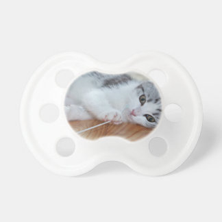Cute Kitten playing with string Baby Pacifier