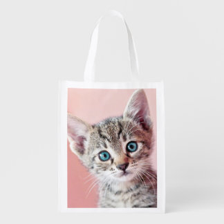 Cute kitten with blue eyes. reusable grocery bag