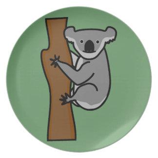 Cute koala bear in a tree dinner plate
