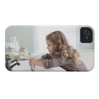 Cute little girl brushing teeth at bathroom sink iPhone 4 Case-Mate cases