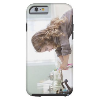 Cute little girl brushing teeth at bathroom sink tough iPhone 6 case