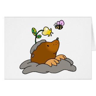 cute mole cartoon with a flower bee card