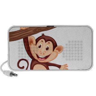 Cute monkey hanging on the branch travel speaker