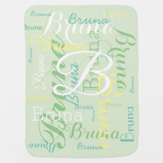 cute monogram with pattern of names on pale green baby blanket