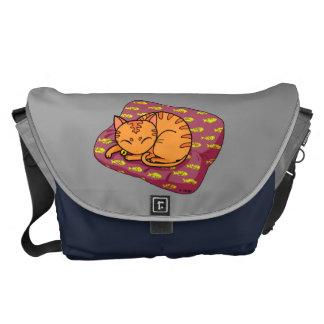 Cute orange cat sleeping commuter bag