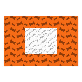Cute orange dog bones pattern photograph