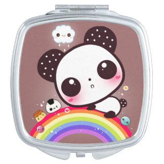 Cute panda with kawaii food on rainbow mirrors for makeup