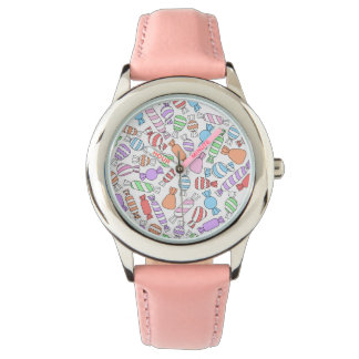 Cute pink kids watch with candies of pastel colors