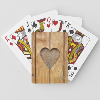 Cute playing cards with one heart on wood