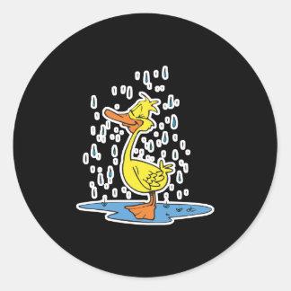 cute puddle duck in the rain round sticker