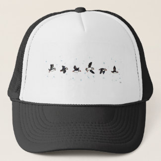 Cute puffins flying trucker hat
