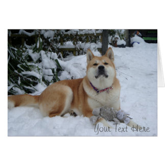 Cute red akita in snow with mouse toy festive card