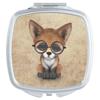Cute Red Fox Cub Wearing Glasses on Aged Texture Makeup Mirror