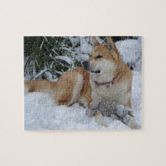 Cute red japanese akita in snow with grey mouse jigsaw puzzle
