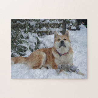 Cute red japanese akita in snow with grey mouse puzzle