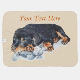 cute rottweiler puppy cuddling gray teddy bear dog baby blanket