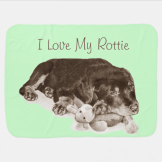 cute rottweiler puppy dog cuddling teddy bear art buggy blanket