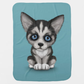 Cute Siberian Husky Puppy Dog on Blue Buggy Blanket