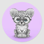 Cute Snow Leopard Cub Wearing Glasses on Purple Round Sticker