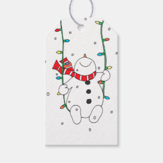 Cute snowman swinging on christmas lights gift tags