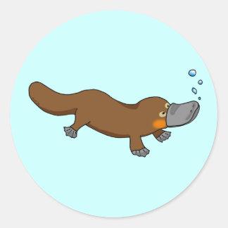Cute swimming duck-billed platypus round sticker