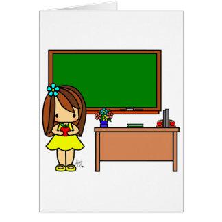Cute Teacher in her classroom holding an apple Card