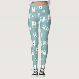 Cute white bunnies on blue background leggings
