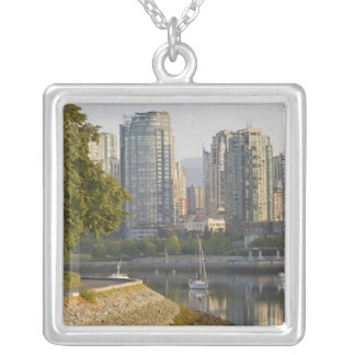 Cyclist along the Seawall Trail in downtown Silver Plated Necklace