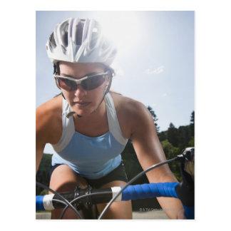 Cyclist on mountain road postcard