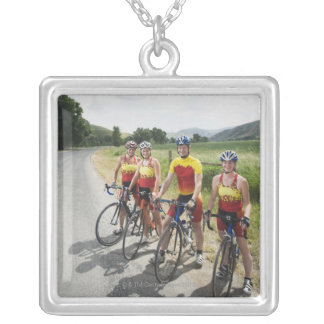 Cyclists posing on country road pendants