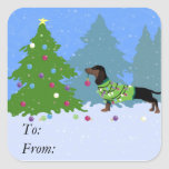Dachshund Decorating Christmas Tree in forest Square Sticker