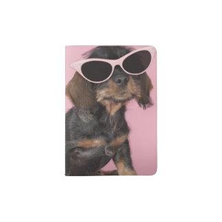 Dachshund puppy wearing sunglasses passport holder