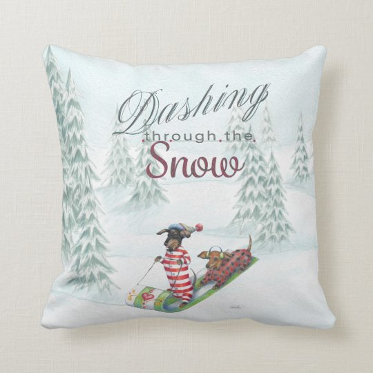 Dachshunds dashing through the snow pillow