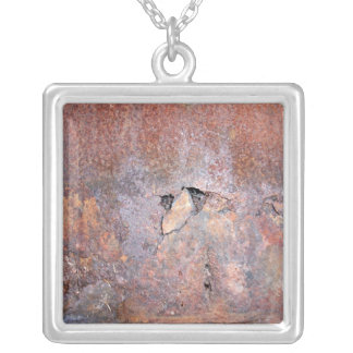 Damaged metal plate with rust texture pendant