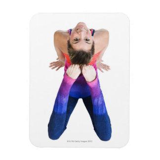 Dancer touching feet to head rectangular photo magnet