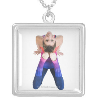 Dancer touching feet to head silver plated necklace