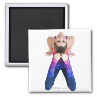 Dancer touching feet to head square magnet