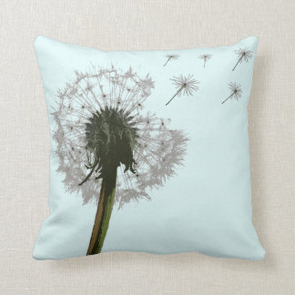 Dandelion blowing, seeds scattering pillows